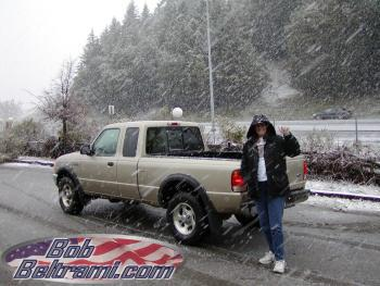 Trish stands in front of the Ranger as the snow falls